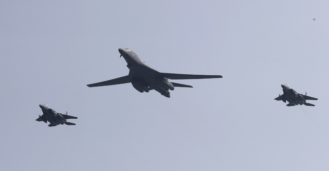 U.S. B-1 bomber, center, flies over Osan Air Base with South Korean jets in Pyeongtaek, South Korea, Tuesday, Sept. 13, 2016. The United States has flown nuclear-capable supersonic bombers over al ...