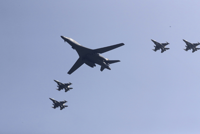 U.S. B-1 bomber flies over Osan Air Base with U.S. jets in Pyeongtaek, South Korea, Tuesday, Sept. 13, 2016. The United States has flown nuclear-capable supersonic bombers over ally South Korea in ...