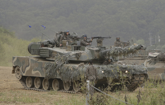A South Korean army's K1 tank moves during an annual exercise in Paju, South Korea, near the border with North Korea, Sunday, Sept. 11, 2016. The U.N. Security Council is strongly condemning North ...
