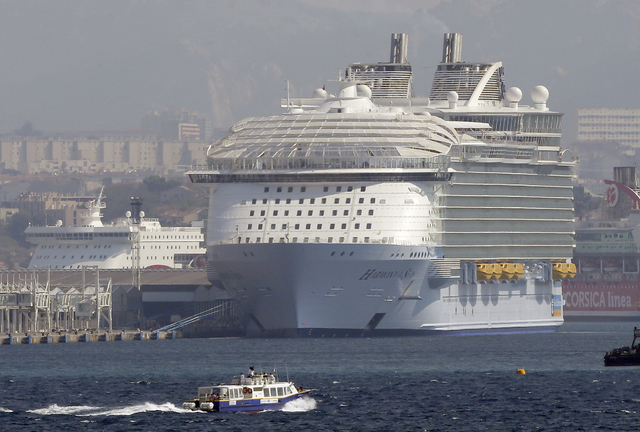 The Harmony of the Seas is docked in Marseille harbor, southern France, Tuesday, Sept. 13, 2016. Royal Caribbean cruise line says a crewmember has died during a lifeboat drill being conducted in M ...