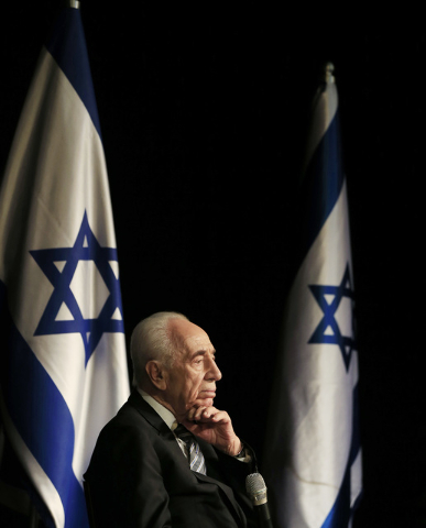 FILE - In this Sunday, July 6, 2014, file photo, Israeli President Shimon Peres talks during a visit in the southern Israeli town of Sderot, Israel. Former Israeli President Shimon Peres on Tuesda ...