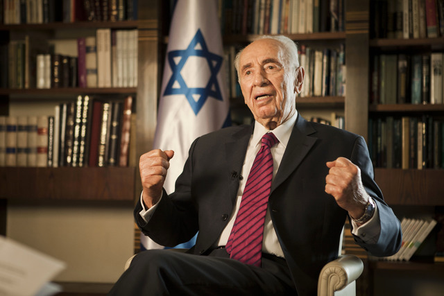 FILE - In this Tuesday, July 15, 2014, file photo, Israel's President Shimon Peres speaks during an interview with The Associated Press, at his residence in Jerusalem. Former Israeli President Shi ...