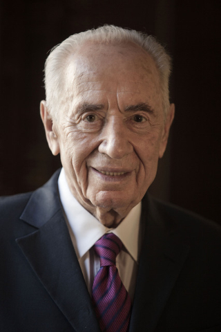 File - In this Tuesday, July 15, 2014 file photo, Israel's President Shimon Peres poses for a photo during an interview with The Associated Press, at his residence in Jerusalem. A spokeswoman for  ...