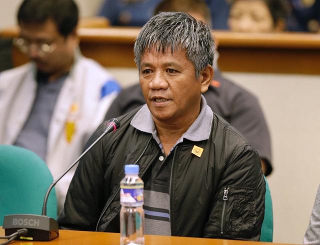 Former Filipino militiaman Edgar Matobato answers questions as he testifies before the Philippine Senate on Thursday. Matobato said that President Rodrigo Duterte, when he was still a city mayor,  ...