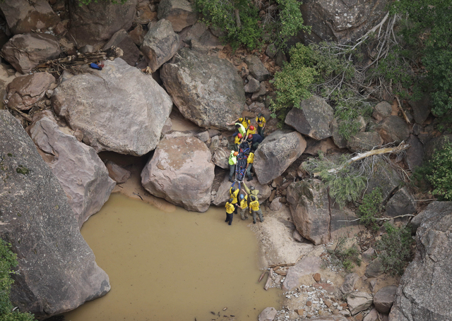 Search and rescue team members carry a body after it was found along Pine Creek in Zion National Park, near Springdale, Utah, Sept. 16, 2015. (Rick Bowmer/AP)