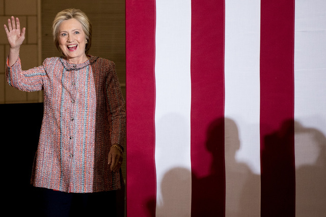 Democratic presidential candidate Hillary Clinton waves as she arrives at a rally at University of North Carolina, in Greensboro, N.C., Thursday, Sept. 15, 2016. Clinton returned to the campaign t ...
