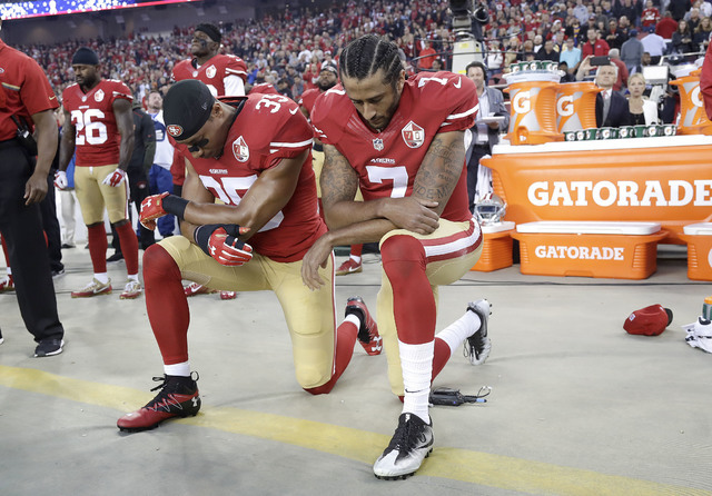 San Francisco 49ers safety Eric Reid (35) and quarterback Colin Kaepernick (7) kneel during the national anthem before an NFL football game against the Los Angeles Rams in Santa Clara, Calif., Mon ...