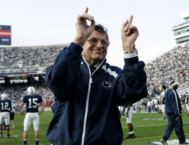 In this Nov. 5, 2005, file photo, Penn State football coach Joe Paterno acknowledges the crowd during warm-ups before an NCAA college football game against Wisconsin in State College, Pa. As Penn  ...