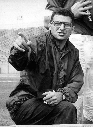 In this Jan. 28, 1965, file photo, Joe Paterno, associate football coach at Penn state, directs players at State College, Pa. As Penn State's athletic department finalizes details for how to honor ...