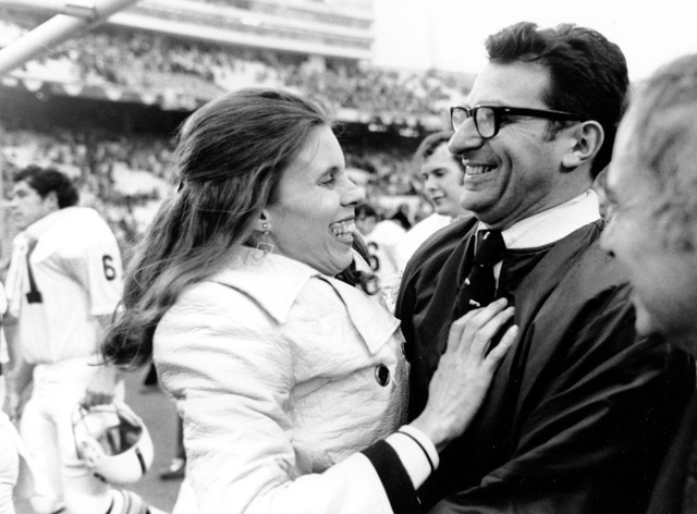 In this Jan. 1, 1972 file photo, Penn State football coach Joe Paterno is embraced by his wife, Sue, following Penn State's 30-6 victory over Texas in the Cotton Bowl in Dallas.As Penn State's ath ...
