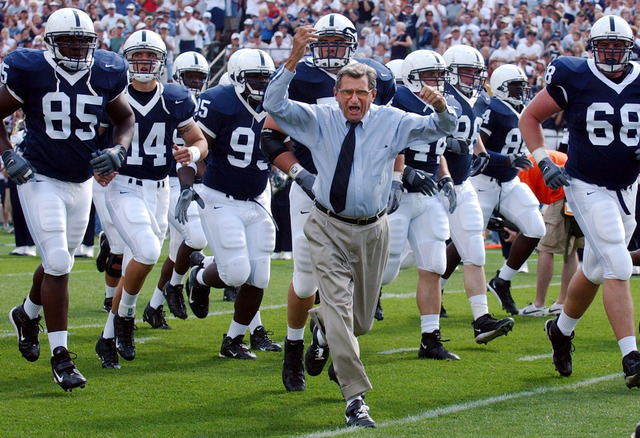 In this Sept. 4, 2004 file photo, Penn State coach Joe Paterno leads his team onto the field before an NCAA college football game against Akron in State College, Pa. As Penn State's athletic depar ...