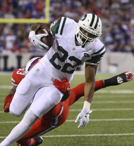New York Jets running back Matt Forte (22) carries against Buffalo Bills linebacker Zach Brown (53) during the second half an NFL football game Thursday, Sept. 15, 2016, in Orchard Park, N.Y. (AP  ...