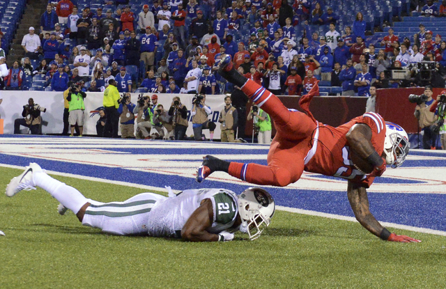 Buffalo Bills running back Mike Gillislee (35) scores a touchdown over New York Jets free safety Marcus Gilchrist (21) during the second half of an NFL football game Thursday, Sept. 15, 2016, in O ...