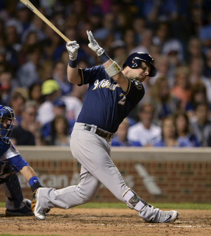 Milwaukee Brewers' Scooter Gennett watches his two-run double during the seventh inning of a baseball game against the Chicago Cubs on Thursday, Sept. 15, 2016, in Chicago. (AP Photo/Paul Beaty)