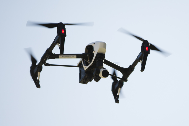 FILE - In this April 14, 2016 file photo, a drone captures videos and still images of an apartment building in Philadelphia. Federal aviation officials say so many people are registering drones an ...