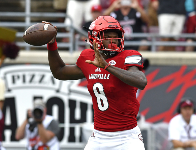 Louisville quarterback Lamar Jackson looks for a receiver during the first quarter of an NCAA college football game against Florida State, Saturday, Sep. 17, 2016 in Louisville Ky. (Timothy D. Eas ...