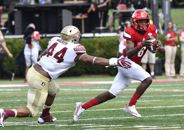 Louisville quarterback Lamar Jackson (8) avoids the tackle form Florida State defensive end DeMarcus Walker (44) during the third quarter of an NCAA college football game, Saturday, Sep. 17, 2016  ...