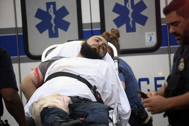 Ahmad Khan Rahami is taken into custody after a shootout with police Monday, Sept. 19, 2016, in Linden, New Jersey. Rahami was wanted for questioning in the bombings that rocked the Chelsea neighb ...