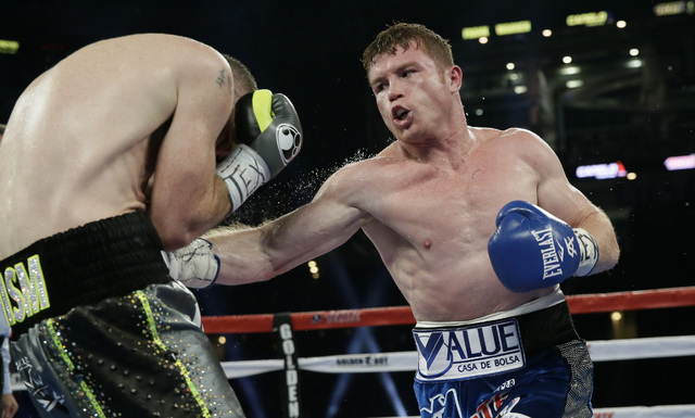 Canelo Alvarez, right, punches Liam Smith, left, during the fifth round of the WBO Junior Middleweight championship boxing match at the stadium in Arlington, Texas, Saturday, Sept. 17, 2016. Alvar ...