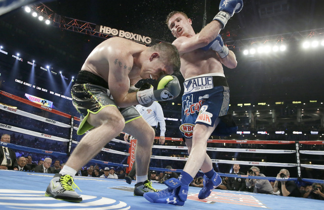 Canelo Alvarez punches Liam Smith during the eight round of the WBO Junior Middleweight championship boxing match at the stadium in Arlington, Texas, Saturday, Sept. 17, 2016. Alvarez won with a k ...