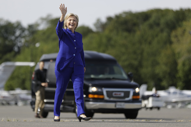 Democratic presidential candidate Hillary Clinton waves as she walks to her campaign plane at Westchester County Airport in White Plains, N.Y., last week. (Matt Rourke/AP)
