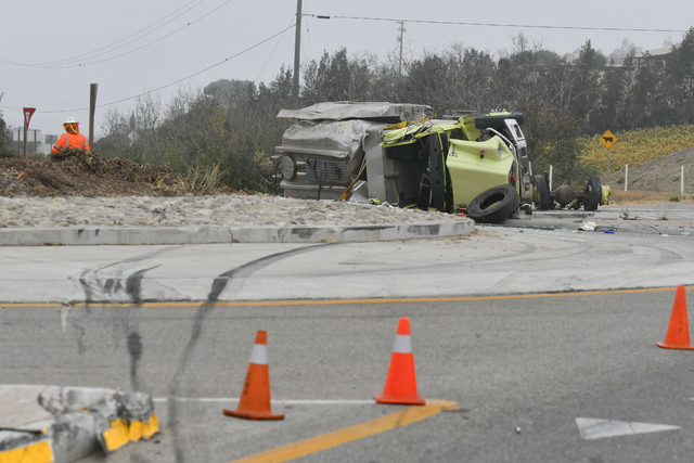 Skid marks lead to the scene of a rollover crash of a water tanker truck near Vandenberg Air Force base that took the life of a Ventura County Fire Dept. firefighter and injured another firefighte ...