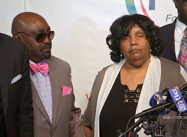 In this photo taken from video, the Rev. Joey Crutcher and Leanna Crutcher, parents of Terence Crutcher, stand at the podium at the National Action Network in New York, Wednesday, Sept. 21, 2016.  ...