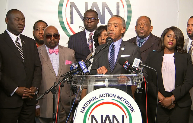In this image taken from video, the Rev. Al Sharpton, center, speaks to the media at the National Action Center in New York, Wednesday, Sept. 21, 2016, about the shooting death of Terence Crutcher ...