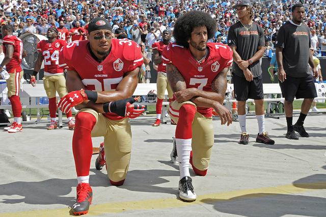 San Francisco 49ers' Colin Kaepernick (7) and Eric Reid (35) kneel during the national anthem before an NFL football game against the Carolina Panthers in Charlotte, N.C., Sunday, Sept. 18, 2016.  ...