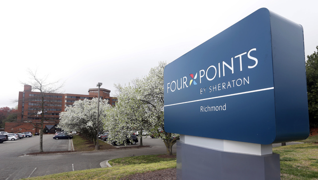This Friday, March 25, 2016, photo shows the sign at the Four Points Sheraton Hotel in Richmond, Va. Marriott International closed early Friday, Sept. 23, 2016, on its acquisition of Starwood Hote ...