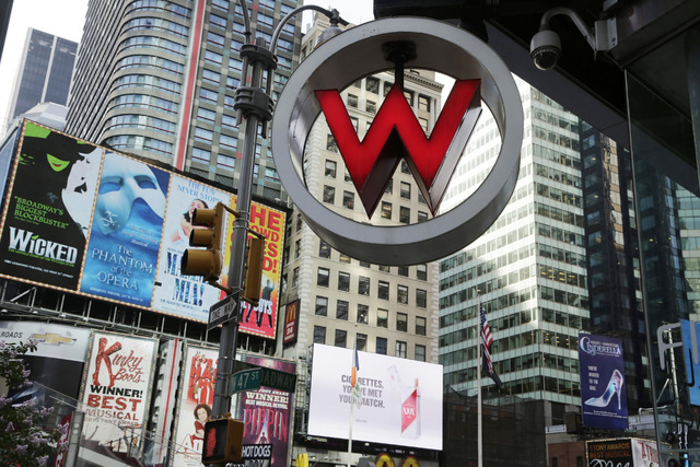 FILE - In this Wednesday, July 31, 2013, file photo, the logo for the W Hotel, owned by Starwood Hotels & Resorts Worldwide, is seen in New York's Times Square. Marriott International closed e ...