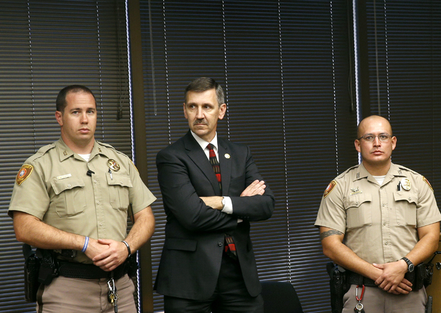 Tulsa District Attorney Steve Kunzweiler, center, stands with Tulsa sheriff's deputies before a news conference, Thursday, Sept. 22, 2016 in Tulsa, Okla. Kunzweiler announced that his office has f ...
