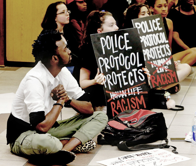 """Protesters fill the food court chanting """"Black Lives Matter"""" in the Oklahoma Memorial Union at the University of Oklahoma on Thursday, Sept. 22, 2016 in Norman, Okla. (Steve Sisney/The Oklahoman v ..."""