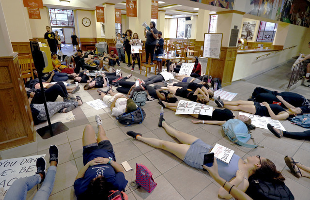 """Over 100 protesters filled the food court chanting """"Black Lives Matter"""" in the Oklahoma Memorial Union at the University of Oklahoma on Thursday, Sept. 22, 2016 in Norman, Okla. (Steve Sisney/The  ..."""