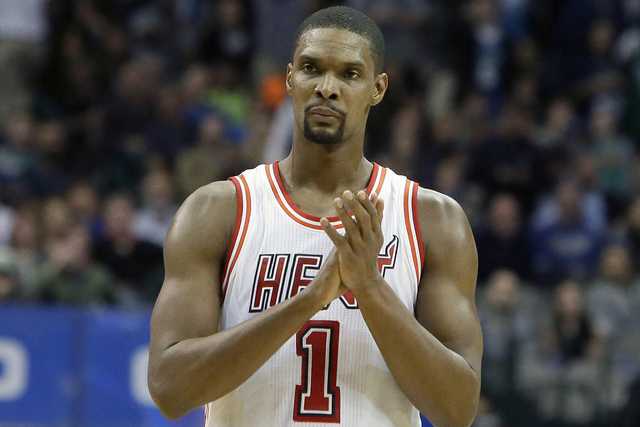 In this Feb. 3, 2016, file photo, Miami Heat forward Chris Bosh (1) reacts to a call during the second half of an NBA basketball game against the Dallas Mavericks, in Dallas. Bosh was dealing with ...