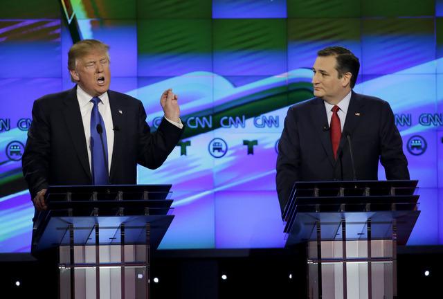 Sen. Ted Cruz, R-Texas, listens as Donald Trump speaks during a Republican presidential primary debate at The University of Houston in Houston, Feb. 25, 2016. (David J. Phillip/AP)