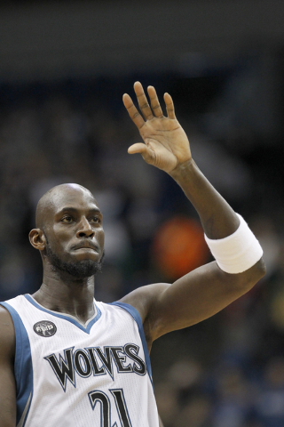 In this Dec. 26, 2015, file photo, Minnesota Timberwolves forward Kevin Garnett (21) waves during the first half of an NBA basketball game against the Indiana Pacers in Minneapolis. A person with  ...