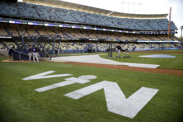 Hall of Fame Los Angeles Dodgers broadcaster Vin Scully's initials are painted on the field at Dodger Stadium before the team's baseball game against the Colorado Rockies, Friday, Sept. 23, 2016,  ...