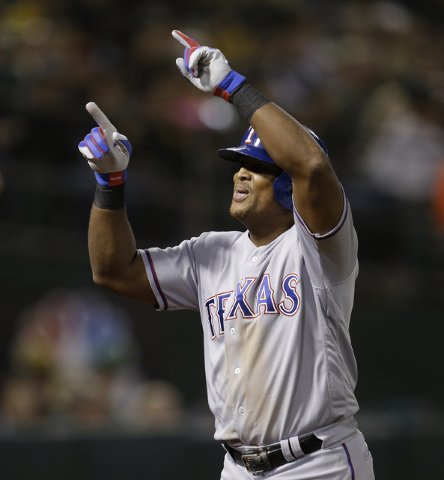 Texas Rangers' Adrian Beltre celebrates after hitting a two-run home run against the Oakland Athletics in the seventh inning of a baseball game Friday, Sept. 23, 2016, in Oakland, Calif. (AP Photo ...