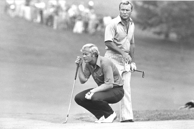 This July 31, 1972, file photo shows Jack Nicklaus kneeling as partner Arnold Palmer looks over his shoulder while they study a putt on 18th green at Laurel Valley Golf Club at the PGA National Te ...