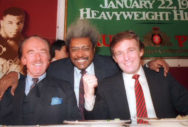 In this Dec. 1987 file photo, Donald Trump, right, pictured with his father, Fred Trump, left, and boxing promoter Don King participate in news conference in Atlantic City, N.J. (AP)