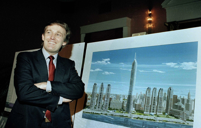 """In this Nov. 18, 1985 file photo, real estate mogul Donald Trump displays an artist's concept of """"Television City,"""" which would be on the far west side of Manhattan. (Marty Lederhandler/AP)"""