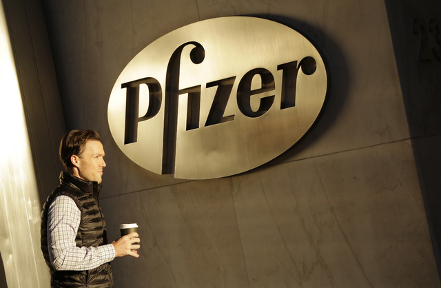 Pfizer announced on Monday it will not split into two publicly traded companies, a decision that, at least for now, ends Wall Street speculation over the drugmaker's future. (Mark Lennihan/AP)