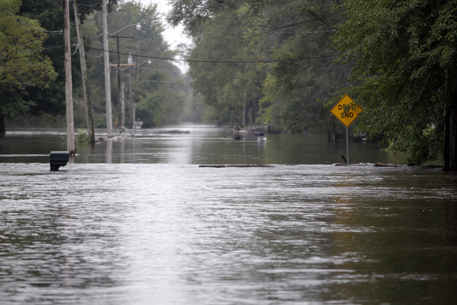 Flood waters close McCoy Road  on Saturday, Sept. 24, 2016, in Evansdale, Iowa. Authorities in several Iowa cities were mobilizing resources Friday to handle flooding from a rain-swollen river tha ...