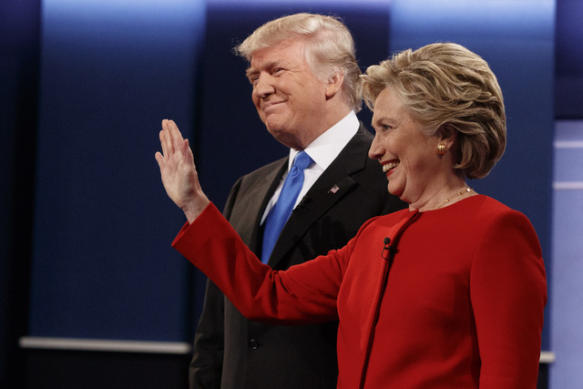 Republican presidential candidate Donald Trump, left, stands with Democratic presidential candidate Hillary Clinton before the first presidential debate at Hofstra University, Monday, Sept. 26, 20 ...
