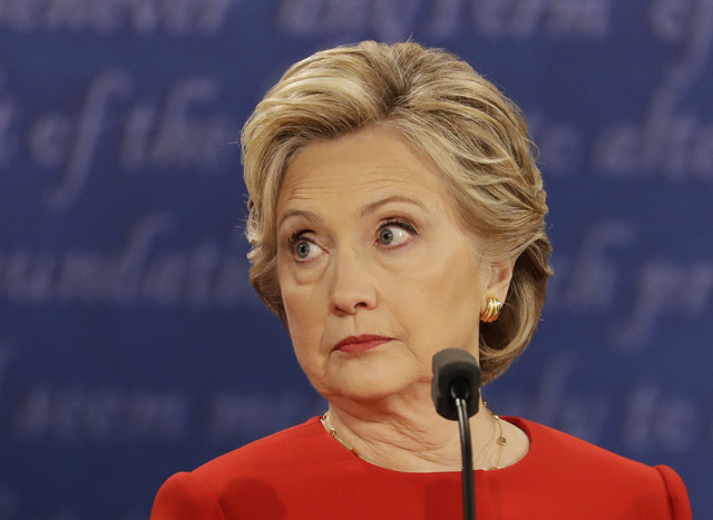 Democratic presidential nominee Hillary Clinton listens to Republican presidential nominee Donald Trump during the presidential debate at Hofstra University in Hempstead, N.Y., Monday, Sept. 26, 2 ...