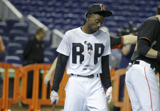 Miami Marlins second baseman Dee Gordon wears a T-shirt reading RIP in honor of pitcher Jose Fernandez during batting practice before a baseball game against the New York Mets, Monday, Sept. 26, 2 ...