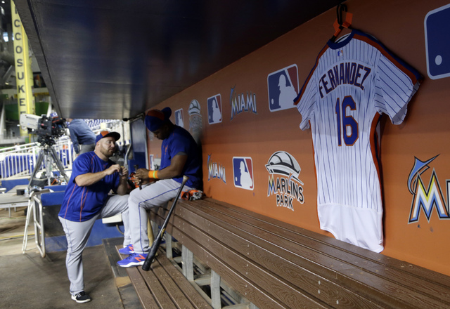 A jersey honoring Miami Marlins pitcher Jose Fernandez hands in the visitor's dugout before a baseball game between the Miami Marlins and the New York Mets, Monday, Sept. 26, 2016, in Miami. Ferna ...