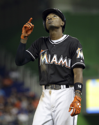 Miami Marlins' Dee Gordon points to the sky after hitting a single during the fourth inning of a baseball game against the New York Mets, Monday, Sept. 26, 2016, in Miami. (AP Photo/Lynne Sladky)