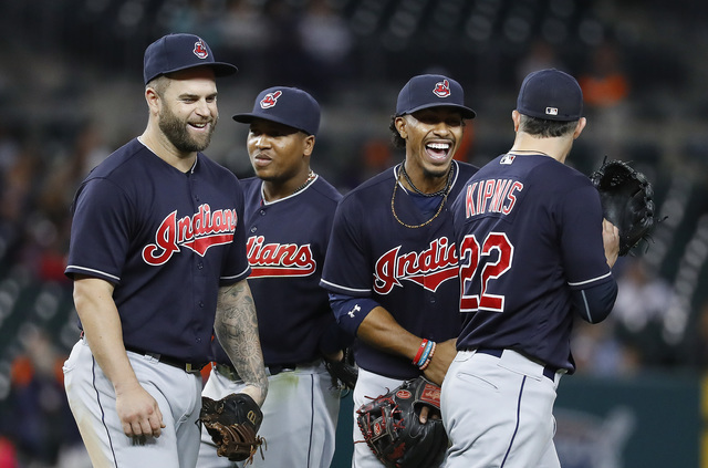 Cleveland Indians' Mike Napoli, Jose Ramirez, Francisco Lindor and Jason Kipnis, from left, smile in the infield during the sixth inning of the team's baseball game against the Detroit Tigers on M ...